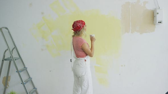 Thumbnail for Female Painter with Drink Looking at Wall