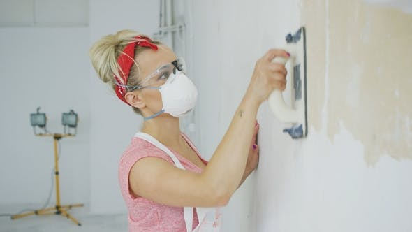 Thumbnail for Woman Grinding Wall with Sandpaper