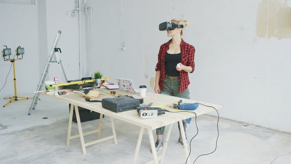 Thumbnail for Woman Using Virtual Reality Goggles in Workshop