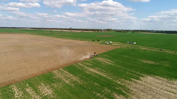 Thumbnail for Aerial Footage of a Tractor on a Field