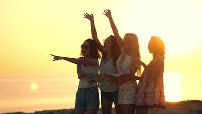 Summer Women Waving Hands at Sunset. Cheerful Women Flirting on Beach
