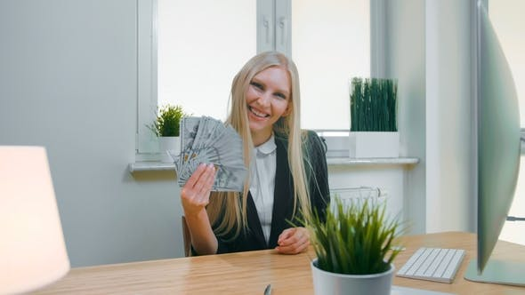 Smiling Business Woman Holding Wad of Cash