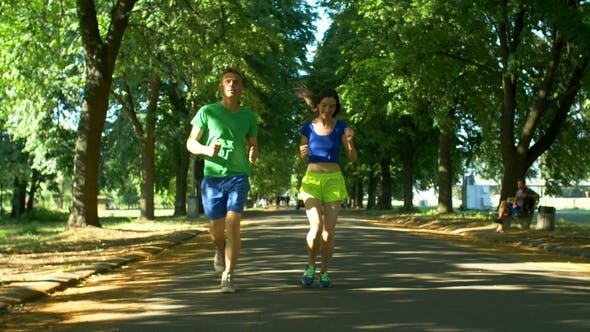 Thumbnail for Athletic Attractive Couple Running in Public Park