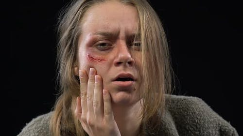 Abused Woman Crying Hard, Feeling Desperate and Defenseless, Spousal Abuse