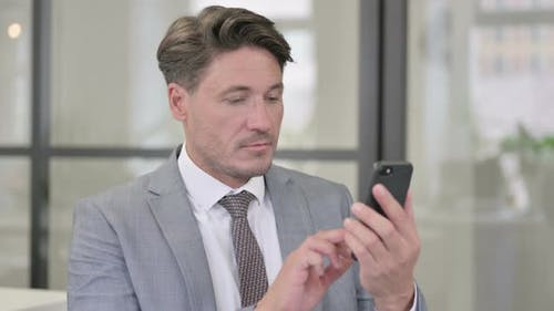 Middle Aged Man using Smartphone