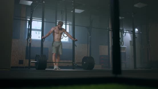 Thumbnail for Bearded Young Man with Naked Torso Is Breathing Heavily After an Intensive Workout in a Gym. Heavy