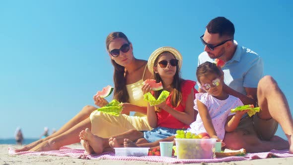 Thumbnail for Happy Family Having Picnic on Summer Beach