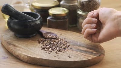 Healthy Flax Seeds Lie on a Wooden Table
