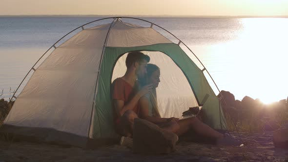 Thumbnail for Couple Chats Online Via Skipe During Camping Trip