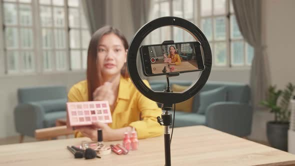 Display Of Smartphone Recording Video Blog For Asia Beauty Blogger Woman With Make-Up At Home Studio