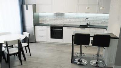 Scandinavian Design Minimalist Kitchen Interior. Light Interior of a White Kitchen in a Compact
