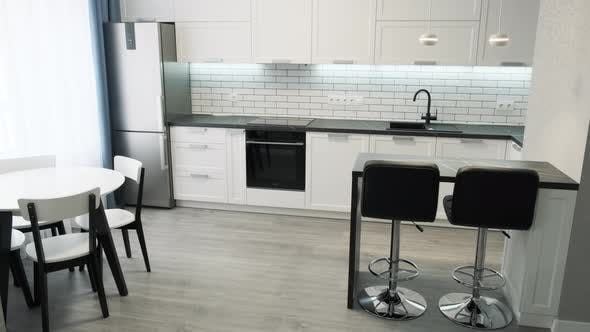 Thumbnail for Scandinavian Design Minimalist Kitchen Interior. Light Interior of a White Kitchen in a Compact