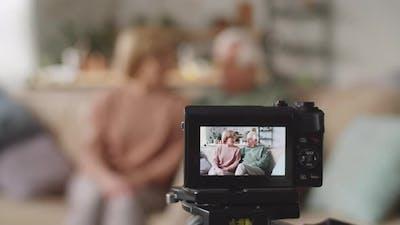 Senior Couple Recording Lifestyle Vlog with Digital Camera