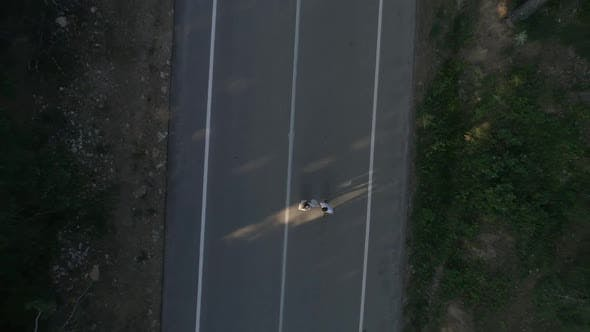 Thumbnail for Couple Walking On Forest Road Aerial View