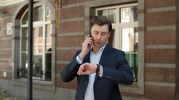 Thumbnail for Closeup Businessman Talking on Phone at Street. Man Having Business Talk Outdoor