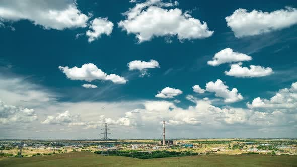 Thumbnail for Industrial Landscape with Power Plant with Yellow Field and Big Blue Clouds