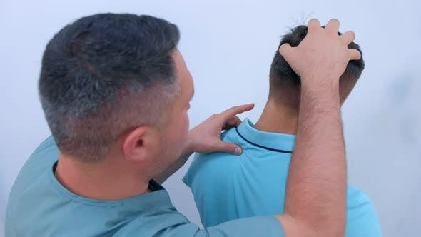 Man on Preventive Examination of Doctor Chiropractor on Spine Diagnostic