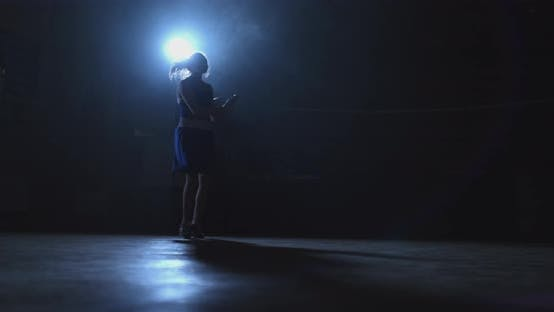 Thumbnail for Training Girl Fighter Jumping Rope in a Dark Room