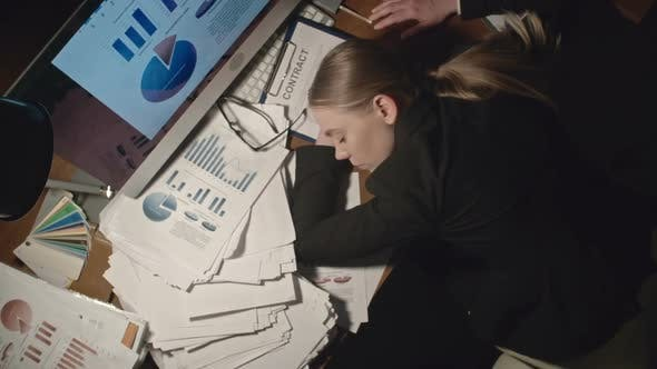 Thumbnail for Exhausted Woman Sleeping at Workplace