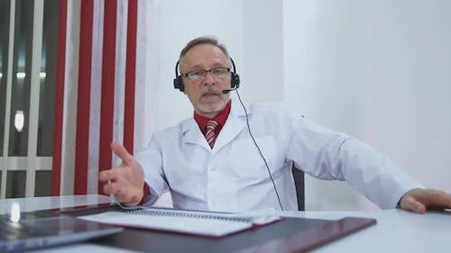 Telemedicine concept. Male doctor listening to patient talking symptom on the internet