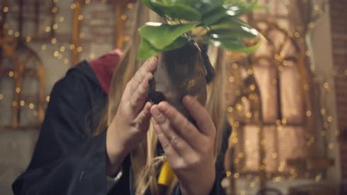 Magic School Student is Holding a Mandragora Root in Botany Class Harry Potter