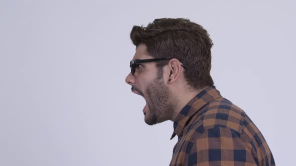 Thumbnail for Profile View of Angry Young Bearded Indian Hipster Man Shouting and Screaming