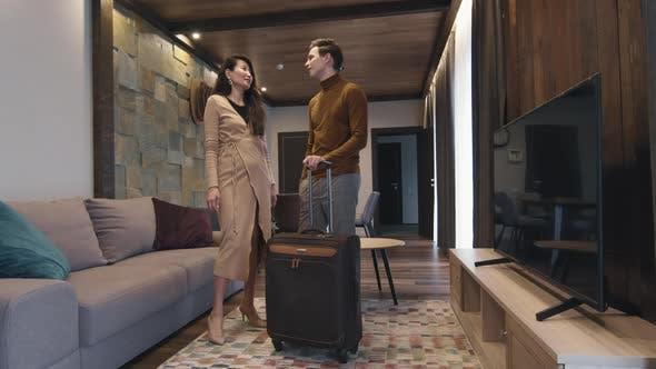 Smart Couple In Hotel Room