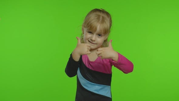Thumbnail for Attractive Kid Ballerina in a Silk Tights Show Thumbs Up in the Studio on Chroma Key Background