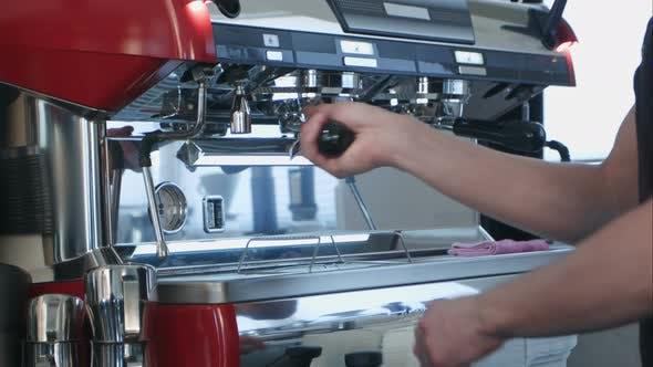 Thumbnail for Barista Using Coffee Machine Preparing Fresh Coffee