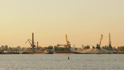 Cargo shipping. Cargo crane terminal, River ship port, Barge with cargo on the river