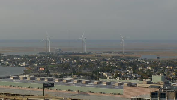 Aerial of flyover, city settlement and windmills in Atlantic city