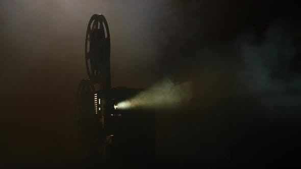 Thumbnail for Shows Movie in a Projector in the Smoke. Black Background
