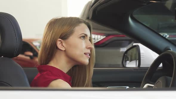 Thumbnail for Gorgeous Woman Posing in Her New Convertible Holding Car Keys
