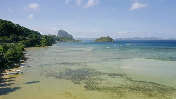 Thumbnail for El Nido, Palawan Island, Philippines - Aerial Drone View of Boats Anchored in the Bay with Clear