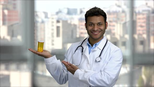 Happy Hindu Doctor Advertising Can of Pills