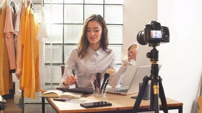 Blogger Shoots a Video on a Professional Camera for Her YouTube Channel. Remote Work During the