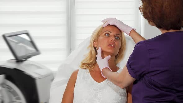 Thumbnail for Mature Woman Having Her Skin Examined By Cosmetologist