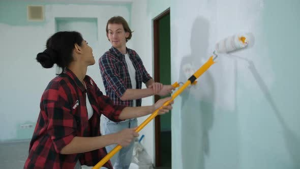 Thumbnail for Cheerful Couple Renovating Home with Fresh Paint