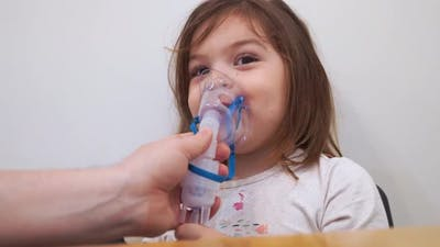 Toddler Girl with Oxygen Nebuliser Treatment at Home