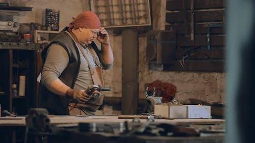 Blacksmith in Protective Glasses