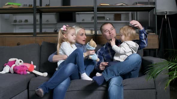 Thumbnail for Happy Family Communicating with Toddler Girl at Home