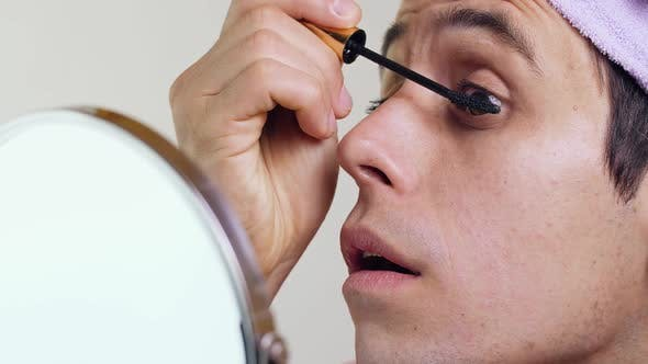 Thumbnail for Gay Man Paints Eyelashes in Front of a Mirror