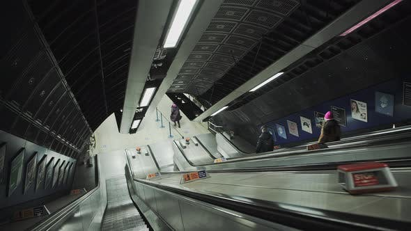 Quiet escalator in London Underground tube train station in Covid-19 Coronavirus pandemic lockdown i