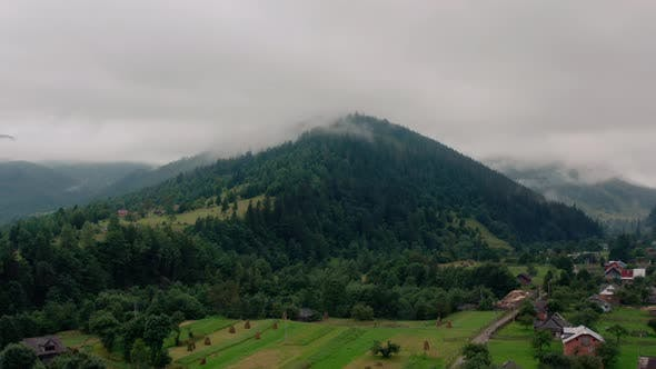 Thumbnail for Aerial View Over Foggy Mountains After Rain V6