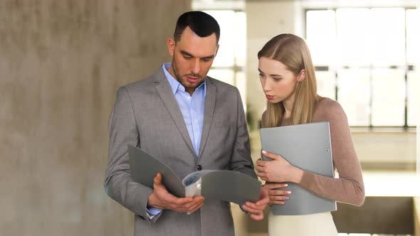 Thumbnail for Businesswoman and Businessman Discussing Folder 2