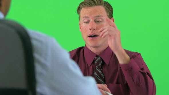 Thumbnail for over the shoulder of two businessmen talking on greenscreen