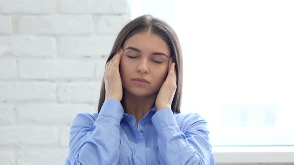 Thumbnail for Hispanic Young Woman Gesturing Headache, Stress