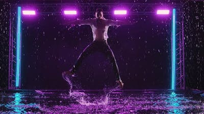 Emotional Performance of Contemporary Ballet Choreography in the Rain in Dark Studio with Purple