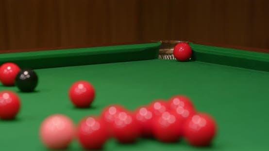 Thumbnail for Striking snooker ball on table