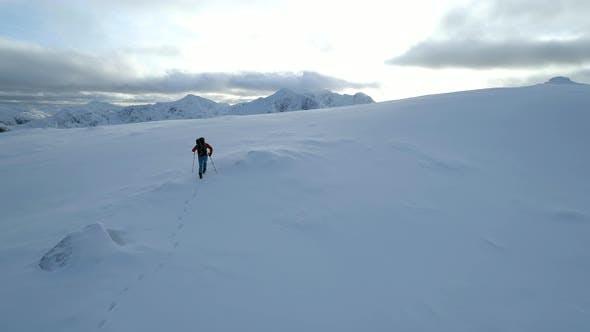 Mountain Climber Reaching the Summit of a Mountain